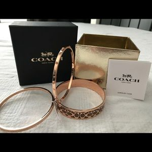 Set of three rose gold Coach bracelets